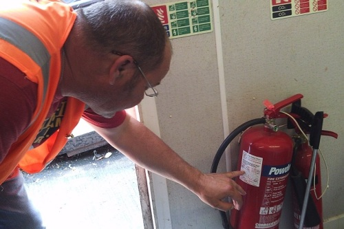 checking fire extinguisher small